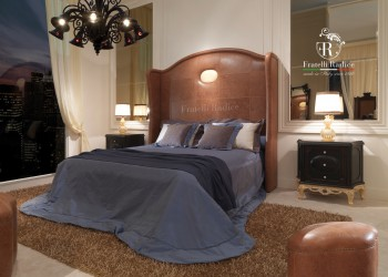 The Vintage leather Contemporary bed has a beautiful upholstered headboard with gilded tableau in the middle.